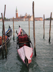Colorful gondolas in Venice, Italy frame the island of San Giorgio Maggiore