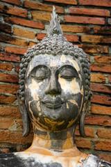 Old Buddha image in Sukhothai Historical Park, Thailand.