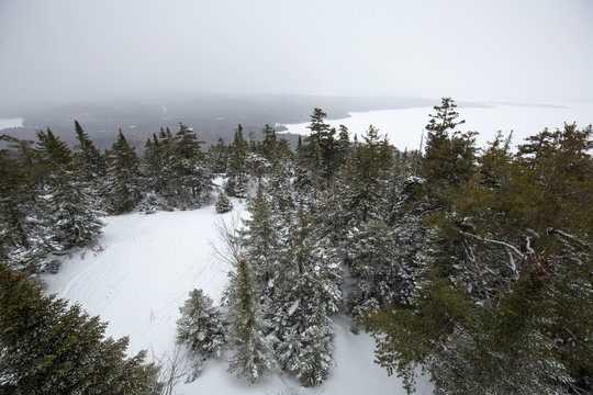 Winter view of icy Rangeley Lake from Bald Mountain, Maine.