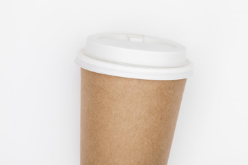 Paper coffee container with white lid on white background. Takeaway drink container. Template of drink cup for your design. Can put text, image, and logo