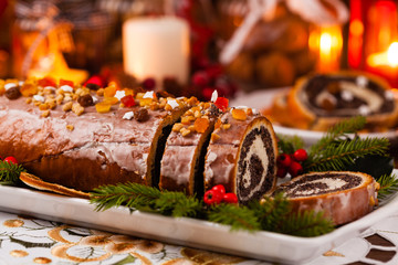 Poppy seed roulade in Christmas decoration. Served with coffee or tea.