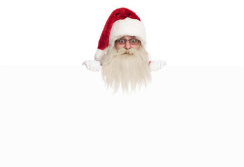 head of santa claus looking over white board