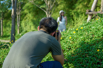Portrait of unidentified man taking the pictuce by camera with blurred landscape in background