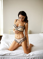 Perfect girl in a sxey white lingerie