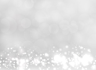 Abstract white and gray blurred light background with bokeh and glitter effect.