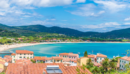 Wall Mural - Panoramic view over marina di campo town in Elba Island, Tuscany, Italy.