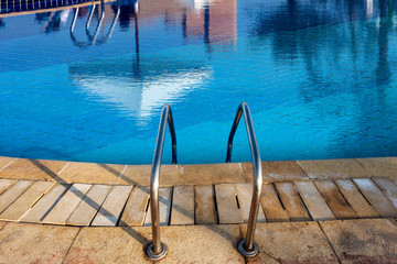 Swimming Pool with Blue Water and Steel Ladder