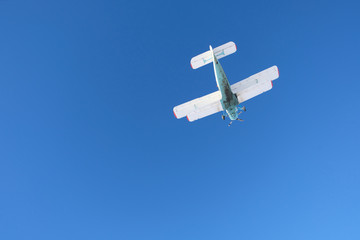 Biplane is in the blue sky.
