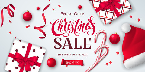 Vector horizontal banner for Christmas sale with gift boxes, Santa Claus hat, candy canes, ribbons, toys and confetti. Elegant festive background for design of flyers for discount and special offers.