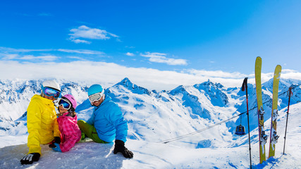 Fototapete - Happy family enjoying winter vacations in mountains, Val Thorens, 3 Valleys, France. Playing with snow and sun in high mountains. Winter holidays.