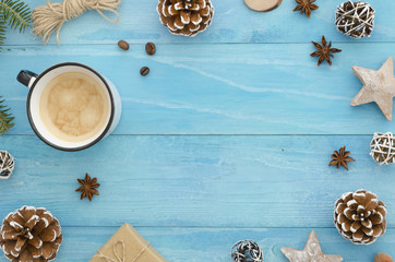 Christmas composition. Coffee cup, rope, anise star, gift and cones on wooden blue background. Winter, christmas concept. Flat lay, top view