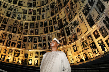 Chadian President Deby looks at pictures of Jews killed in the Holocaust during a visit to Yad Vashem World Holocaust Remembrance Center in Jerusalem