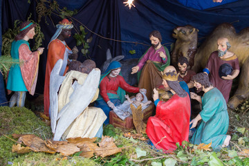 Nativity scene of Christ with colored figures,Christmas Nativity Scene with Three Wise Men Presenting Gifts to Baby Jesus, Holy Mary and Joseph