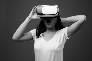 Young beautiful Asian woman using virtual reality glasses