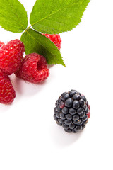 Ripe raspberries with leaf and blackberry isolated on white background.