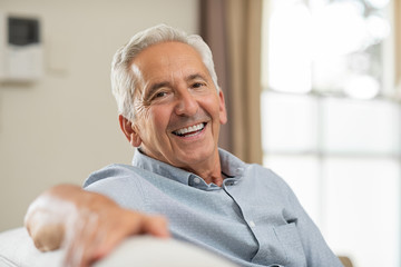 Senior man smiling at home Wall mural
