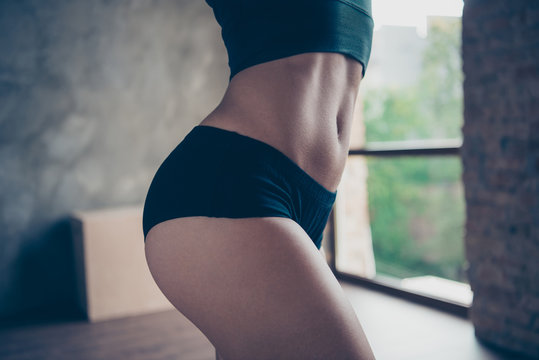 Cropped close-up belly hip thin waist of stylish enduring fitnes