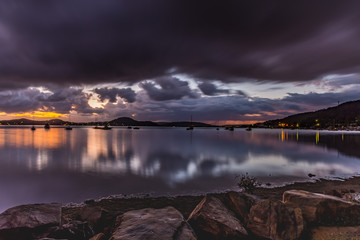 First Light with Heavy Rain Clouds on the Bay