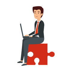 businessman sitting in puzzle piece with laptop