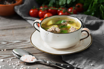Soup with meatballs. Rustic style