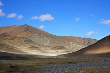 Beautiful views of the steppe and mountains with sky blue or clouds of Western Mongolia