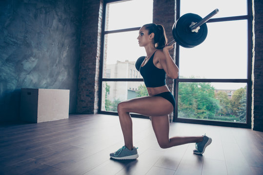 Beautiful strong willful enduring muscular sporty lady wearing t