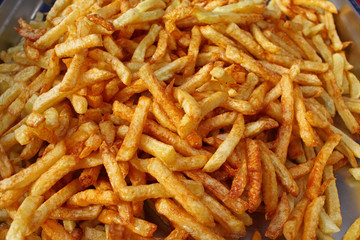Tasty french fries full frame photo. Fat oiled French fries. Diet killing fried potatoes. Pile of fried potatoes. Potato chips background patter. French fries wallpaper. USA fast food concept.