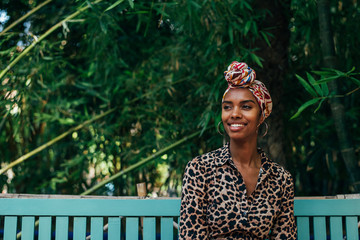 Woman with head wrap in a beautiful garden