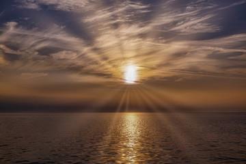 Beautiful sunset over Black sea. Gold sea sunset.