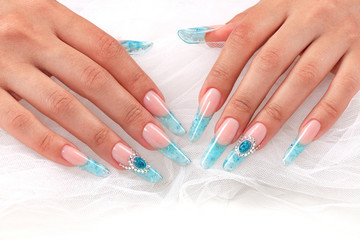 Closeup shot of long female fingers with long beautiful nails