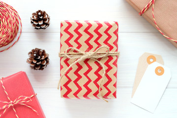 Brown and red vintage gift box and ornament on white wood background, Christmas, new year, valentine's day and anniversary greeting card background