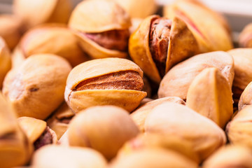 Close-up of pistachio. Selective focus on foreground.Pistachios texture. Nuts. Roasted salted pistachio nuts healthy delicious food studio photo.