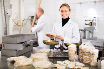 Woman standing with box of turron at factory