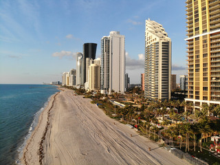 Aerial Drone shot above Sunny Isles Beach at time of sunrise, Florida