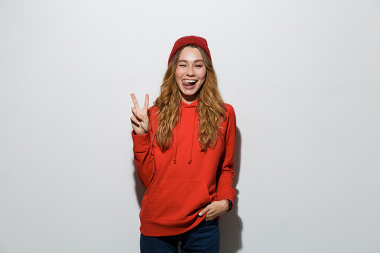 Portrait of a cheerful young woman wearing hoodie