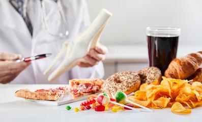 Doctor showing link between bad food and disease