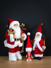 Three Santa Claus figures