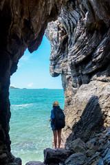 Travel people lifestyle women tourist in summertime and vacations trip in the cave near  sea in Keo Sichang, holiday tourist, Thailand. Travel Concept.