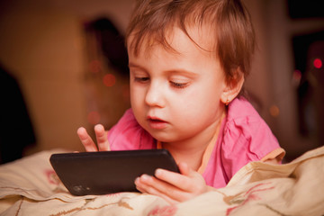 Social Media addiction. Little cute child girl typing text message on mobile phone (psychological problems, media mania, education concept)