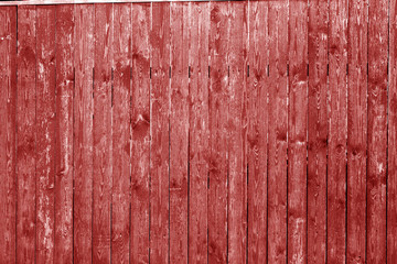Old wooden wall in red color.