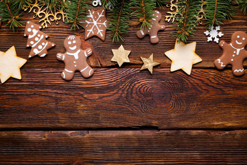 Gingerbread cookies for Christmas, stars and snowflakes on old wooden table