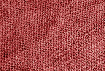 Linen cloth texture in red color.