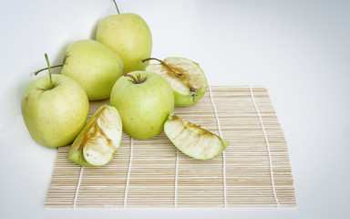 Healthy green food with apples on plates white background top view