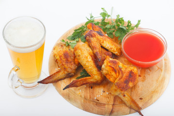 Barbecue chicken wings with red sauce and beer. Grilled chicken wings with glass of beer..