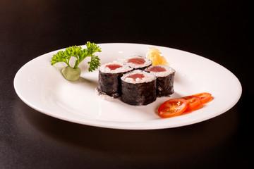 Sushi plate on black background