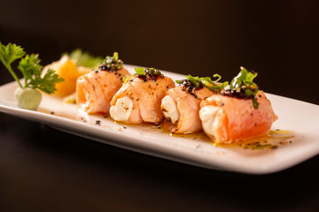 Delicious philadelphia sushi roll with grilled salmon and cream cheese.