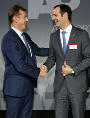 Antonoaldo Neves, CEO of TAP Air Portugal, shakes hands with Guillaume Faury, President of Airbus Commercial Aircraft during the delivery of the first A330neo commercial passenger aircraft for TAP Air Portugal airline in Toulouse