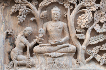 Stone statue of buddha at Mahabodhi Temple Complex in Bodh Gaya, India