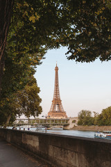 Seine and Eiffel Tower in autumn, sunlight.