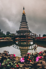 Stupa Doi Inthanon and the bridge over the water in thailand